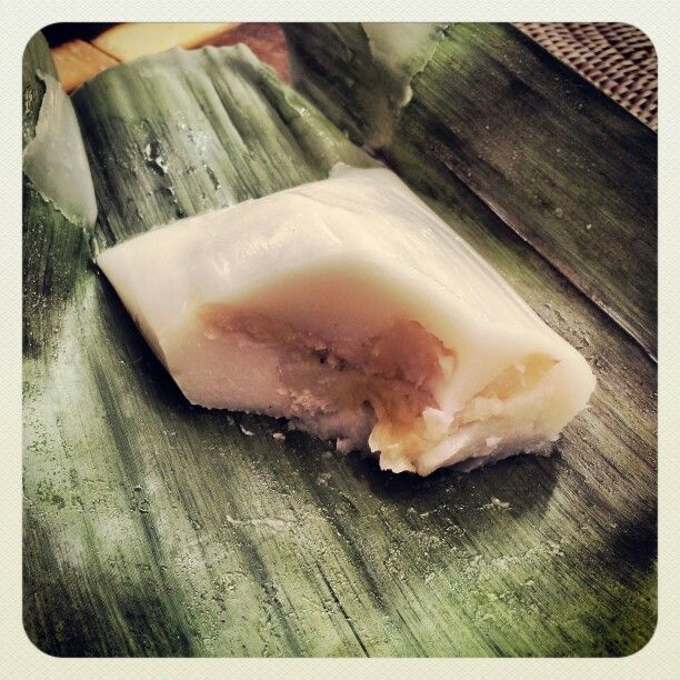 Steamed Banana with coconut milk wrapped in banana leaf