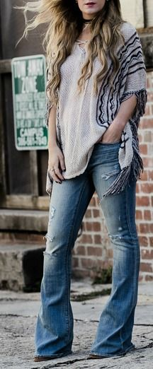 how to style flared jeans with fringe poncho for a casual boho outfit
