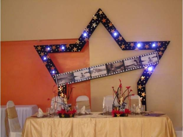 Hollywood theme behind main table for quinceanera Quinceanera