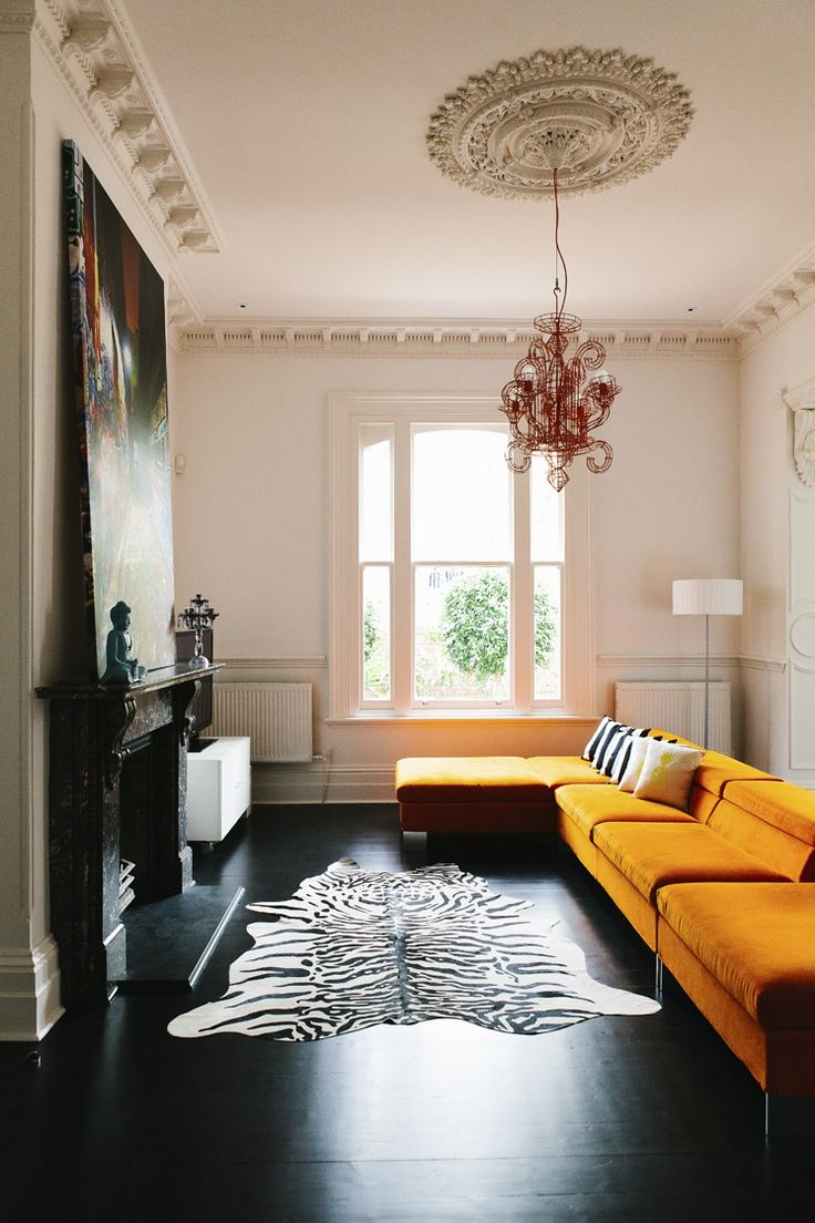 This Living Room In Mish Lilley S Uniquely Designed Home Is Complete With A Bright Yellow Sofa And Zebra Hide Rug Over Dark Stained Hardwood Floors