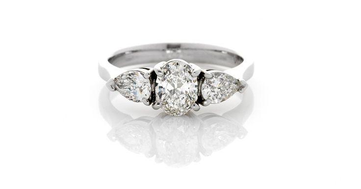 Azena Elegant Diamond Ring Featuring Oval Diamond With Pear Shape Diamonds