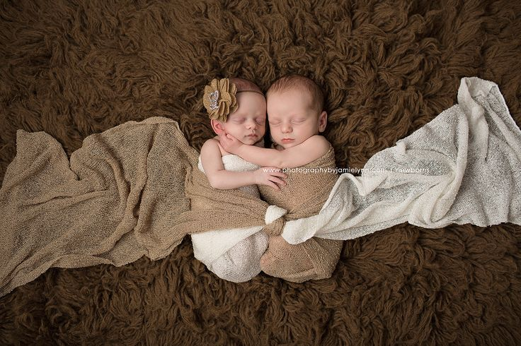 Newborn twins in 2 wraps tied together