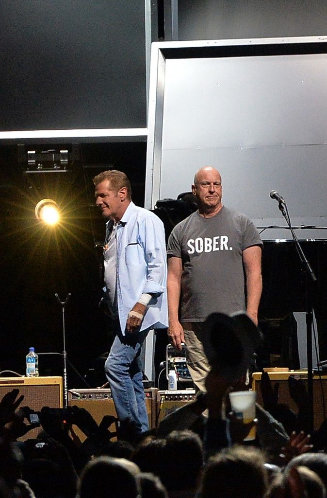 """Glen Frey and Bernie Leadon of the Eagles perform during """"History Of The Eagles Live In Concert"""" at the Bridgestone Arena on October 16, 2013 in Nashville, Tennessee."""