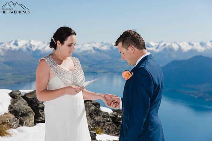 Spring elopement Queenstown, bride reads vows during wedding on The Ledge. Destination Heli weddings Queenstown.