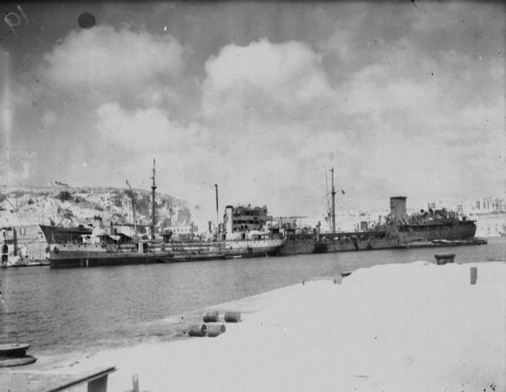 OPERATION PEDESTAL AUGUST 1942.Vital resupply convoy to Malta.15 August:Arrival of OHIO at Malta:Tanker OHIO discharging oil into oilers BOXALL & PLUMLEAF.Probably most important ship in convoy with cargo 11,000tons of petrol desperately needed to maintain aircraft flying from Malta.Torpdoed 12 August & damaged by bombs on 13 August & forced to drop out of convoy.Brought into Malta by a superb feat of seamanship involving her own crew & the destroyers HMS PENN & LEDBURY.