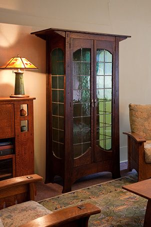 "Tall Display/China Cabinet from Cold River Furniture. (Too bad we can't see more of the rug! Looks like our Voysey ""Orchard"". :)"