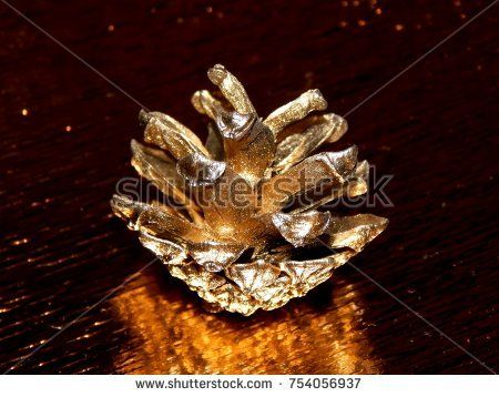 Gold cone on a golden shiny background