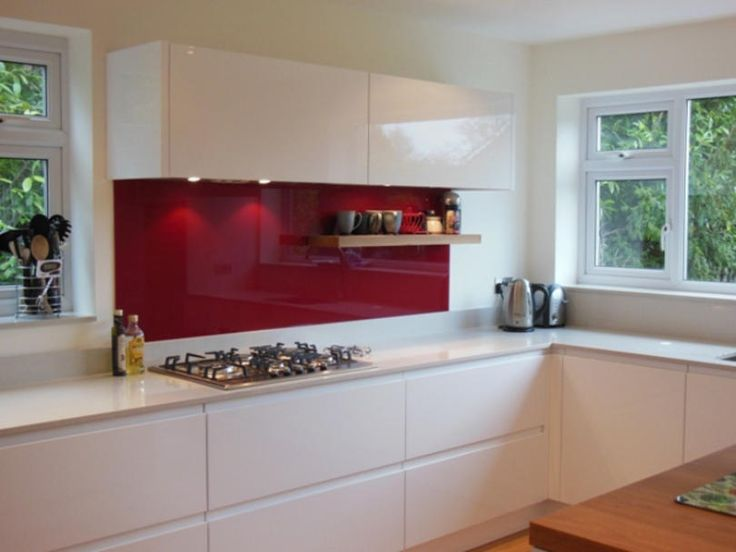 Fabulous kitchen in Remo high gloss white, designed and installed by Elements Kitchens in Reading www.elementskitchens.co.uk Stunning red glass splashback!