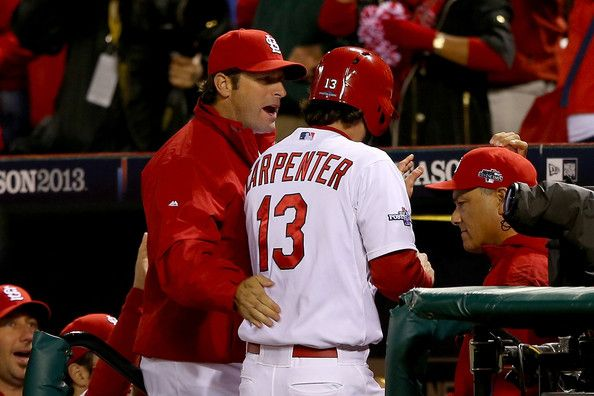 Mike Matheny Photos - Manager Mike Matheny #22 celebrates with Matt Carpenter #13 of the St. Louis Cardinals after Carpenter scores a run in the third inning against the Los Angeles Dodgers in Game Six of the National League Championship Series at Busch Stadium on October 18, 2013 in St Louis, Missouri. - Los Angeles Dodgers v St Louis Cardinals