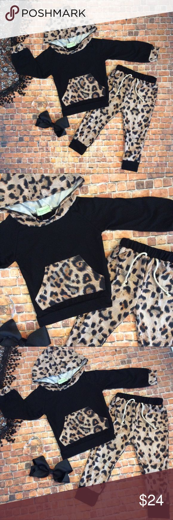 Boutique Baby Girl 2pc hoodie Track Suit Precious animal print & black 2 pc hooded outfit. Black top with animal print hoodie, large pocket& pants. Hair bow is available for purchase on a separate listing. Bundle to save $$. Thanks! Matching Sets