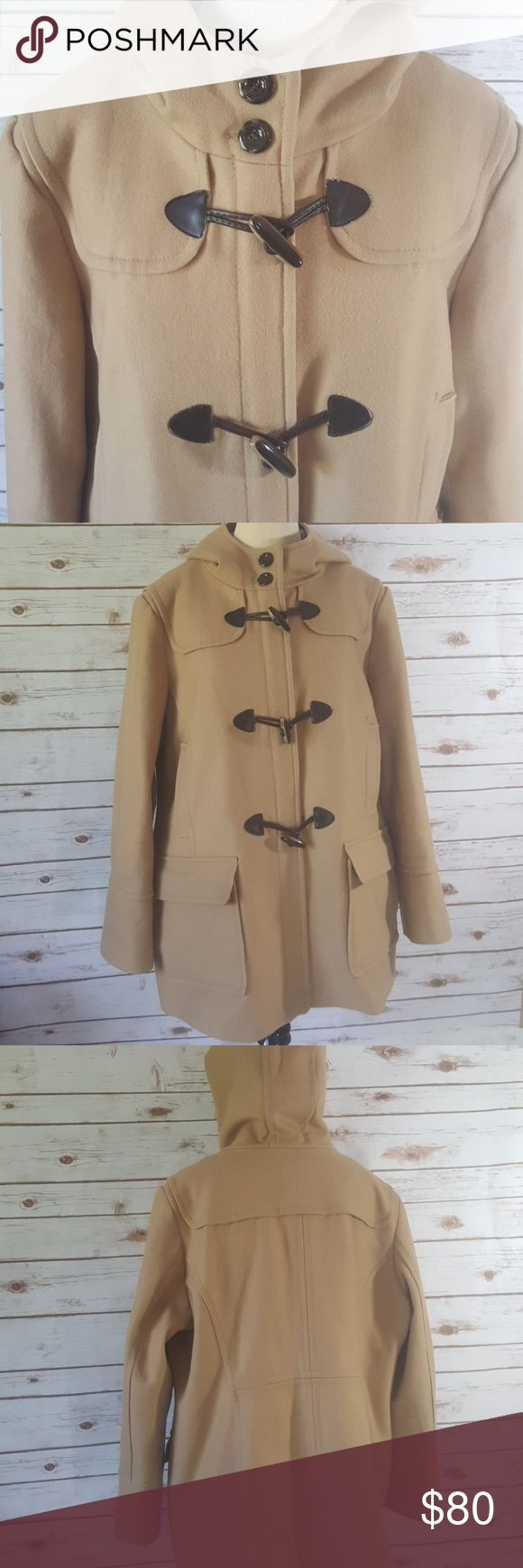 """St. John's Bay wool cashmere blend winter coat St John's Bay women's plus size coat. Underarm to underarm measurement is 26"""". Length is 31"""" from top of shoulder to hem of coat. Zips up the front with three toggle button closures. Four front pockets. Lining intact. Zipper intact. In excellent condition. Size 2X. Made in China. Shell is 70% wool, 20% nylon 10% cashmere. Lining 100% polyester. Hood lining 100% acrylic. Camel / tan in color. Smoke-free pet-free. St. John's Bay Jackets & Coats"""