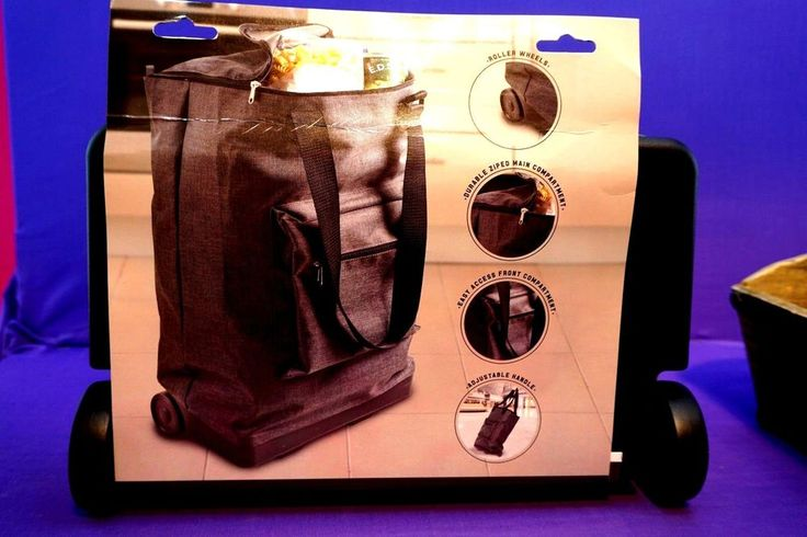 GREY SHOPPING BAG ON WHEELS  ITS SO AMAZING YOU CAN FIT SO MUCH IN EASY TO PULL