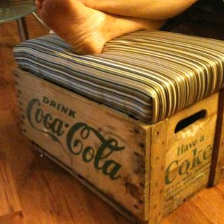 I made this!  Foot stool out of an old Coke crate!  My first DIY -- I LOVE IT!  (Also, upholstering is HARD.)
