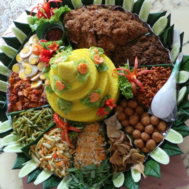 """""""Nasi Tumpeng Komplit"""" is one of the traditional dishes consumed to celebrate a special occasion in Indonesia, especially in Java"""