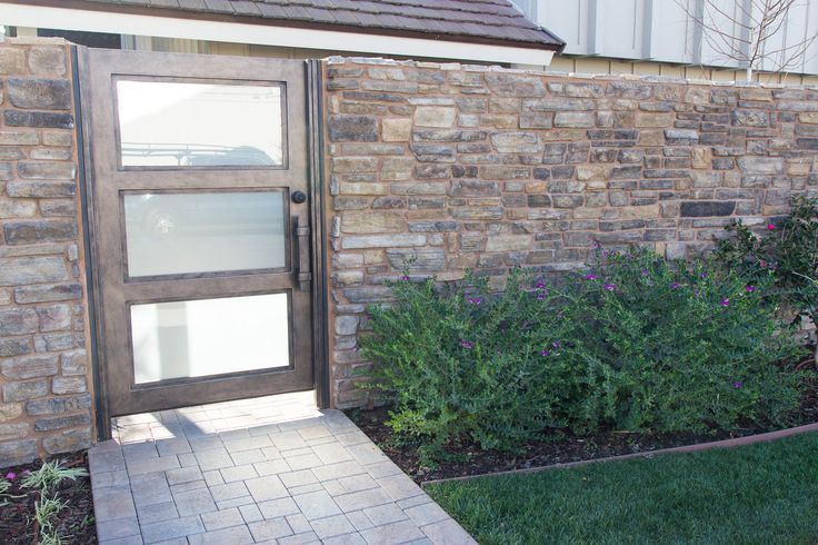 #brick pavers leading to the entrance to the foyer. #natural rock walls surround the #foyer What do you think of the entrance?