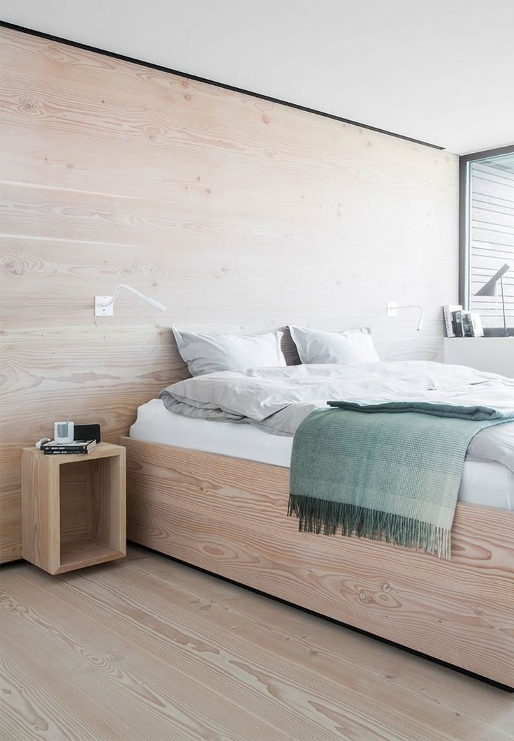 Bedroom covered in Douglas fir - floor, bed and bedside table. Calm and clean look.