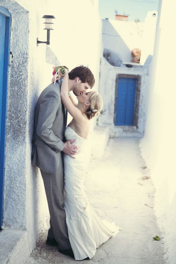 Lovely picture of the bride and groom stealing a kiss.  Photo by Anna Roussos