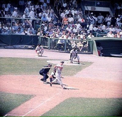 Stan Musial takes big swing vs Mets during a 1962 game at the Polo Grounds.