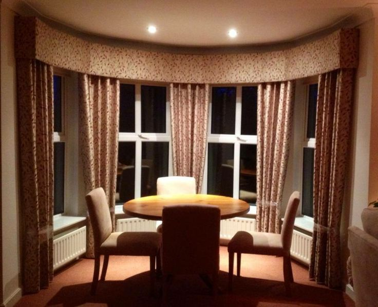 Curved Bay Window Dressed With Padded Pelmet And Curtains