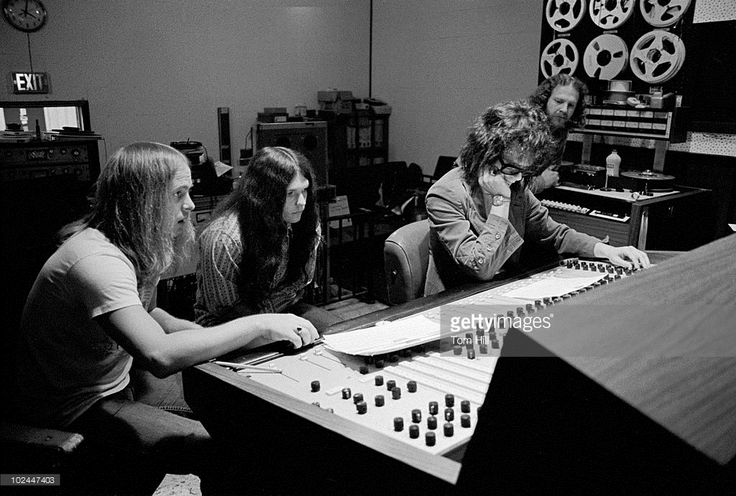 Ronnie Van Zant, Gary Rossington and Billy Powell with producer Al Kooper (2nd R) at the controls and engineer Bob 'Tub' Langford looking on (R) during Lynyrd Skynyrd recording session for their debut LP 'Pronounced Leh-nerd Skin-nerd' at Studio I in Doraville, Atlanta, Georgia, on May 6, 1973.