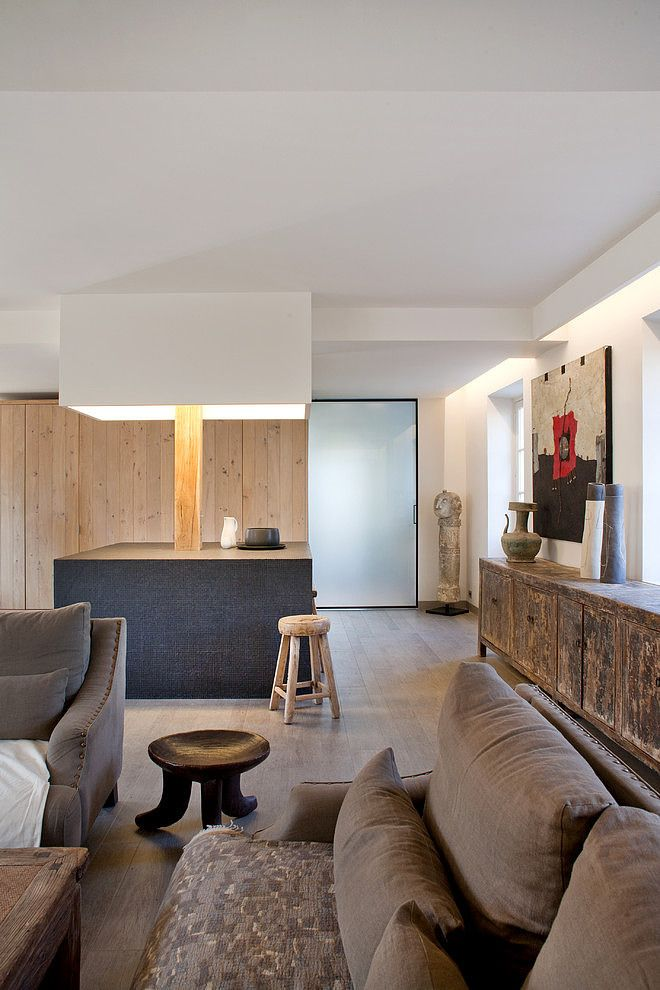 A modern rustic ethnic inspired interior of a home in molières bright neutral stunner of a loft in paris in villennes sur seine france designed or