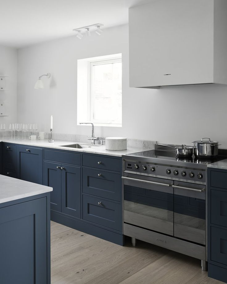 Nordic Shaker kitchen - Nordiska Kök A modern Shaker kitchen built in classic style. The dark grey-blue color together with the bare white walls and industrial touches give the kitchen a modern tone. For more kitchen inspiration visit www.nordiskakok.se #kitchen #bespokekitchen #shakerkitchen #shaker #interior #architect #grey #limestone #white #framekitchen #minimalism #minimalistic #wood #kitchendesign #kitchenideas #greykitchen #design #designtrends #beautifulkitchens
