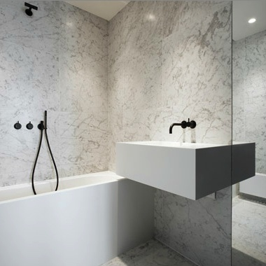 Materials combo: carrara marble, white, mirror and Black vola fittings