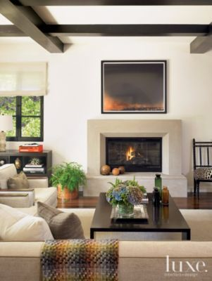 Geometric Contemporary fireplace.  Simple angle on the cut out and hearth