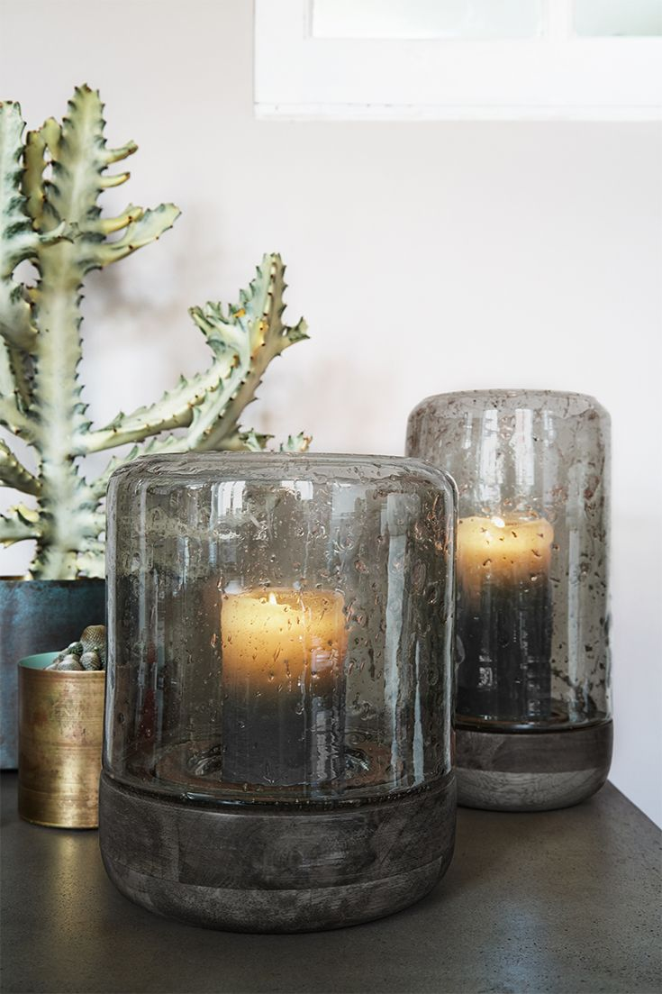 We often use candle lights as finishing touches when decorating a space, but these hand made hurricane lamps from Cozy Living are a feature in and of themselves. #scandinavian #scandinavianinterior #scandinaviandesign #scandi #scandihome #interiordesign #homewares #hygge #nordic #nordicdesign #gifts #cosy #danishdesign #danish #candles #candlelights #glass #wood