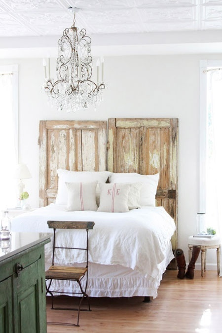 Antique chippy doors upcycled into a stunning headboard.....