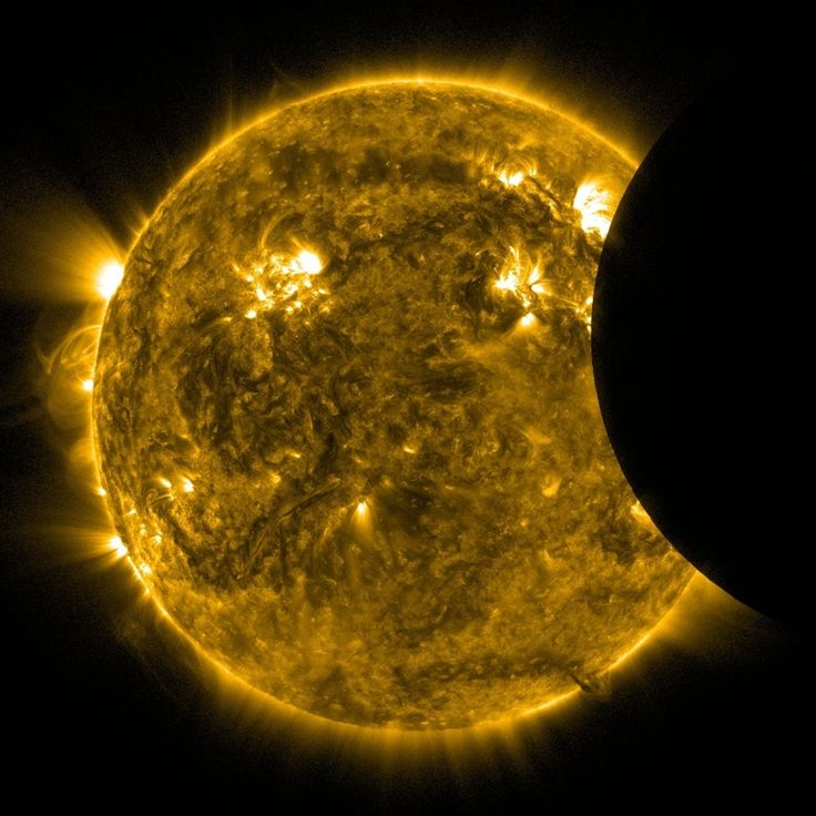The moon takes a bite out of the sun's disk in this extreme ultraviolet view from NASA's Solar Dynamics Observatory