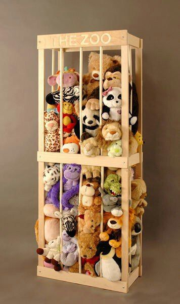 The zoo toy storage. Use old book shelf put on its side- drill holes and use dowels close enough together that its safe and baby won't be able to fit head inside.