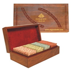 Super Deluxe Wooden Gift Box -- This elegant engraved box of sheesham wood is lined with rich red velvet cloth and holds 100 teabags. Comes with 25 tea bags of each variant of ORGANIC INDIA Tulsi Tea - The Original Tulsi, Tulsi Ginger, Tulsi Green Tea, and Tulsi Chai Masala. Makes a great impression on everyone and will last a lifetime! Special Option: You can have your customized logo engraved on the top of this box!