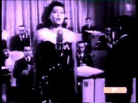 "Nilla Pizzi sings ""Grazie dei fiori"" [Thanks for the Flowers] (1951), with conductor Cinico Angelini and his Orchestra. This song won the first edition of the Sanremo Italian Song Festival."