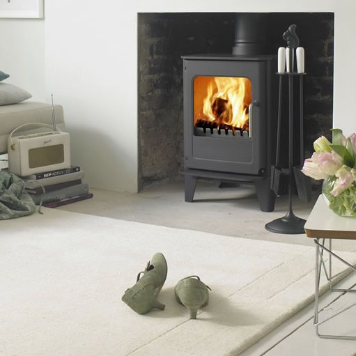 The smallest model from the Morsø Ø-Collection of wood burning stoves, the stylish Ø4 incorporating the state-of-the art Fire-Slide control, offers big stove performance but with small stove output.