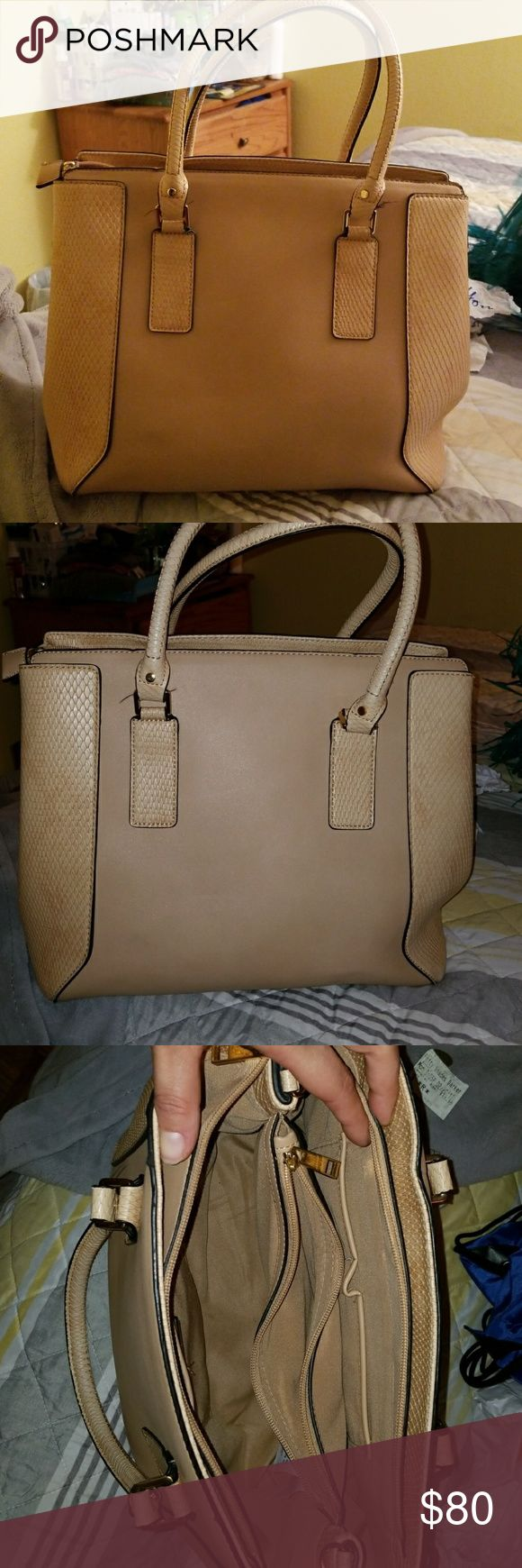 Aldo  TAN large tote Color is a creamy tan AUTHENTIC ALDO tote bag. Bag is pretty large inside comes with 3 compartments inside perfect for storing alot of items looks very nice when carrying. Aldo Bags Totes