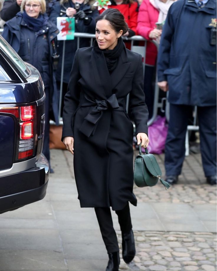 """2,316 Likes, 41 Comments - HELLO! Canada Magazine (@hellocanadamag) on Instagram: """"She's back in black! Meghan Markle looked super chic in a black coat by #StellaMcCartney as she and…"""""""