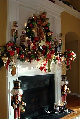 This is a beautiful way to decorate a fireplace mantel for Christmas....would replace the nutcrackers with column candles.