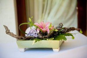 modern centrepiece with lilies, hydrangeas, twigs and foliage