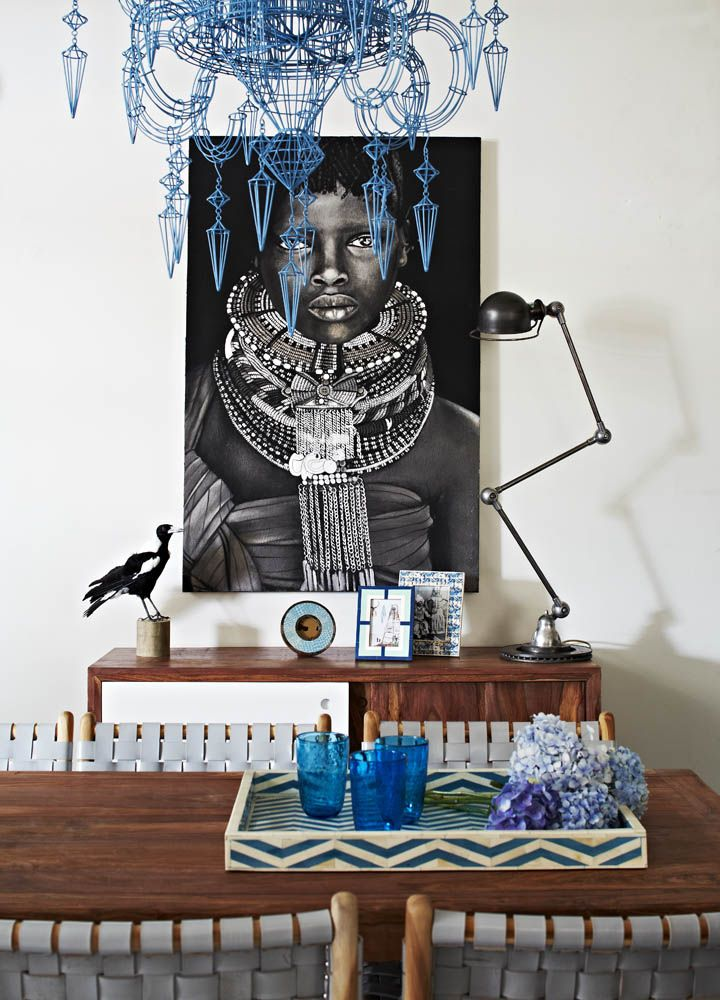 Eclectic diningroom with large ethnographic portrait photo