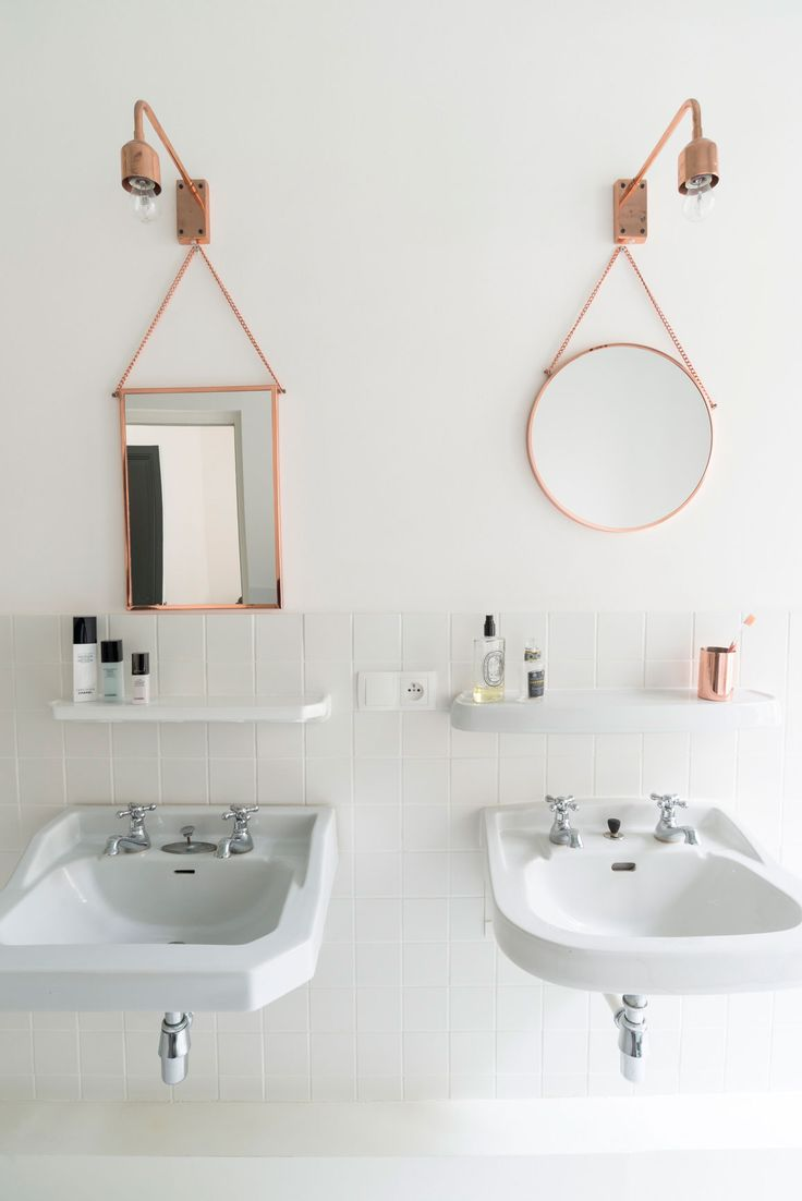 Really like this idea of using double old-time sinks w/shelfs, mismatched mirrors.  Alas, my bathroom is too small to do this.