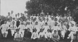 colonial priyayi; blangkon with white suite, bow tie, batik cloth