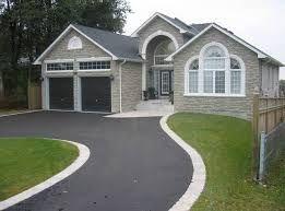 Paver stones edging paved driveway