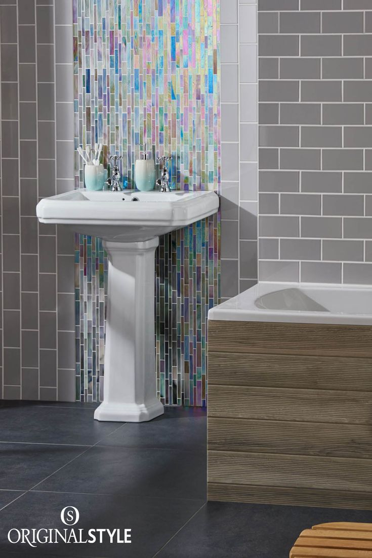 Wall Tiles by Original Style, Artworks Range, Westminster Grey Half Tile. The classic brick shape gives this bathroom a contemporary touch, whilst the muted grey is enhanced by the iridescent mosaic panel behind the sink.