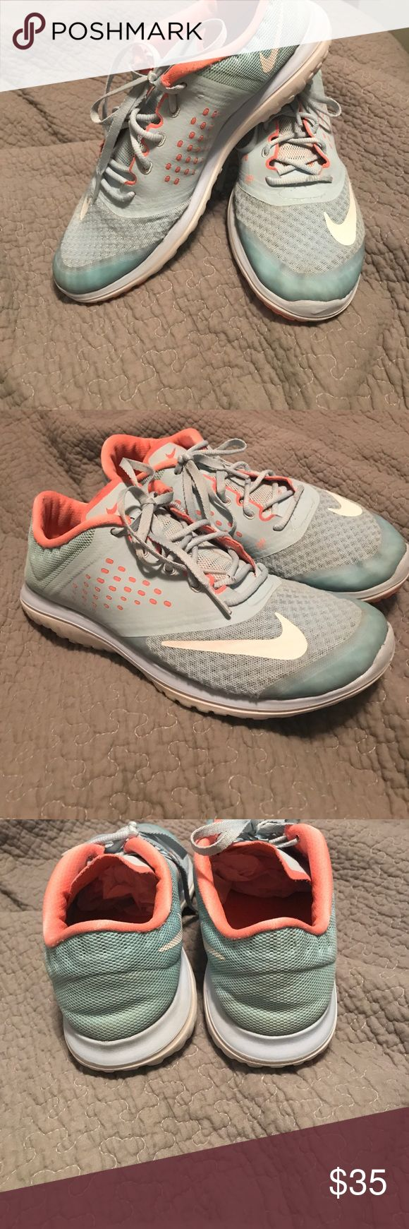 NIKE Tiffany Blue & Coral Running Shoes Size 8.5 Adorable NIKES! Tiffany Blue and Coral with white accents. Some spots that could be cleaned, but I'm pretty good shape. One spot where the plastic coating was scratched off during a run. Lots of life left. Reasonable Offers welcome via the offer button ONLY, no trades Nike Shoes Athletic Shoes