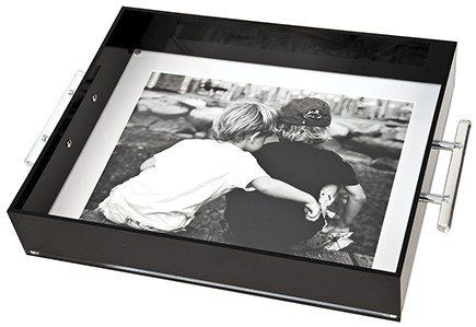 Forget a traditional photo album; display a favorite picture of the kids on this oversize photo tray ($250)...