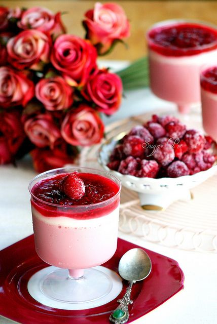 A stunningly beautifully styled shot of Raspberry Bavarois with Raspberry Coulis and Sugar Dusted Raspberries