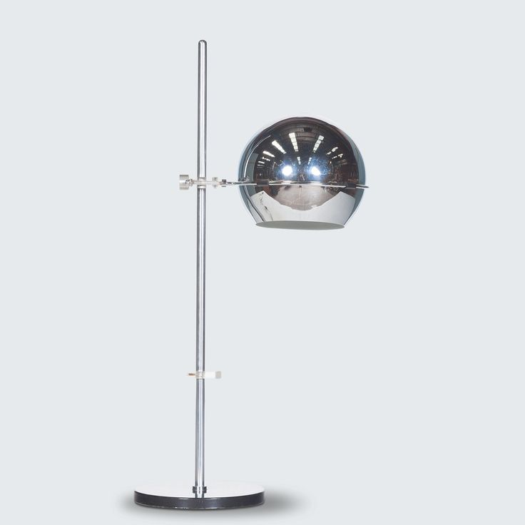 RAAK CHROME ORB TABLE LAMP line Stunning chrome table lamp with a black metal base, perspex adjustable fittings and ball stand which allows the lamp to lean and distribute light from different angles.