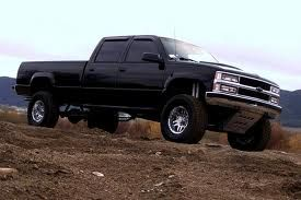 I had a red 1996 chevy silverado that I bought for my hubby. Mine wasn't this jacked up but it was huge! I loved driving that monster!