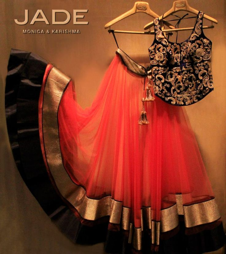 Enchanting rich velvet blue and gold corset with the refreshing coral lehenga